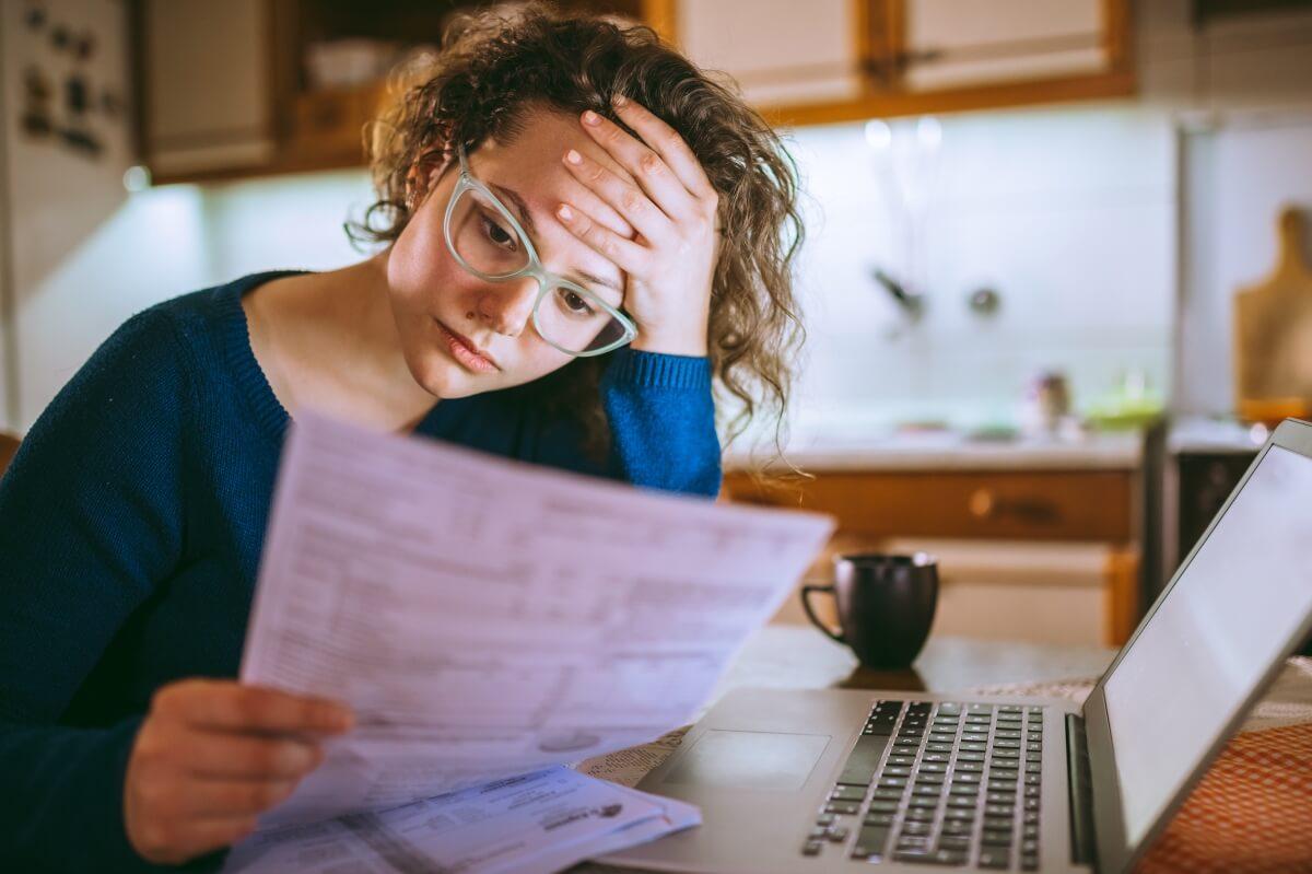 Woman looking at utility bills